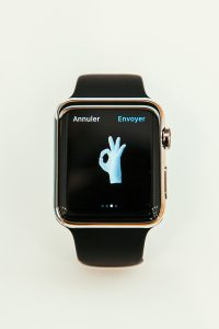PARIS FRANCE - APR 10 2015: New wearable computer Apple Watch smartwatch displaying the new OK Sign emoji. Apple Watch incorporates fitness tracking and health-oriented capabilities and integration with iOS Apple products and services
